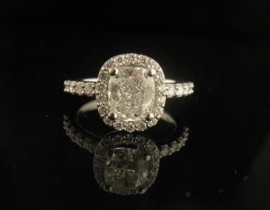 Platinum and white gold Cushion cut diamond halo engagement ring