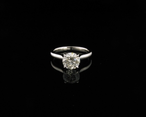 1 x Custom made Platinum Diamond Engagement Ring. Platinum four claw tapered setting. Set with 1 x 1.18ct round brilliant cut K VS1 Diamond. Setting features pear shaped claws.