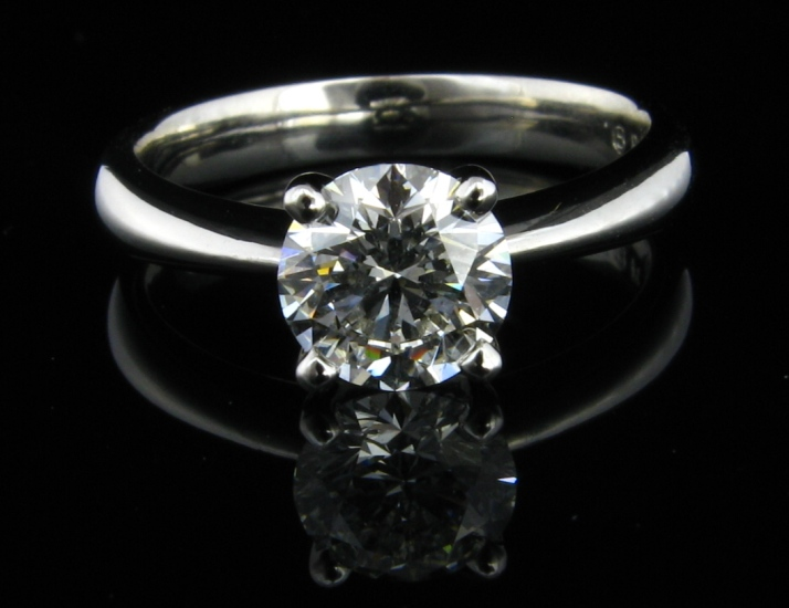 18ct White Gold Diamond Engagement Ring. Set with 1 x .75ct F SI1 round brilliant cut diamond.  GIA Certified and laser inscribed - Triple Excellent.