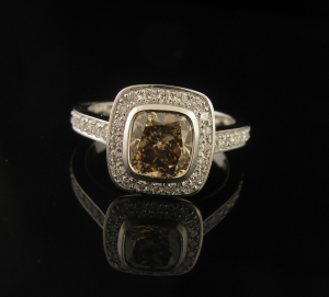 1.50ct Cushion cut Champagne Diamond. Pave set with .50ct diamonds in the halo and band.