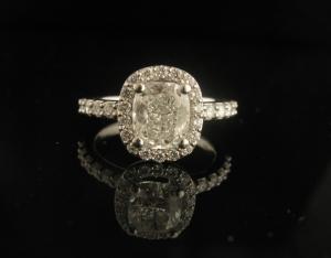 Platinum and white gold Cushion cut diamond halo engagement ring