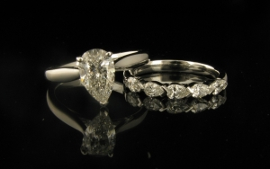 1 x Custom made 18ct White gold Diamond Engagement Ring. 18ct White gold three claw tapered basket setting – set with 1 x 1.03ct Pear cut G SI1 Diamond.